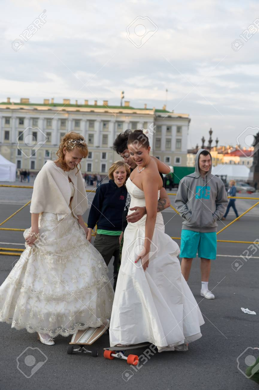 Action «Run-away brides of Cosmopolitan» — a flashmob of long-distance scale which was spent the seventh year.  Russia, St. Petersburg Stock Photo - 13386455