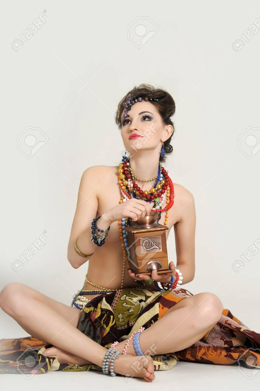 girl with a wooden coffee grinder in hand Stock Photo - 17909351