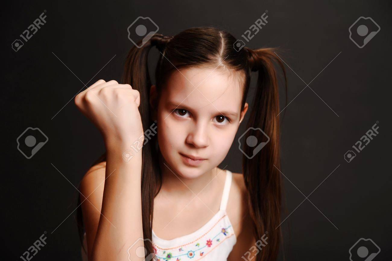 The girl the teenager becomes angry Stock Photo - 13444911