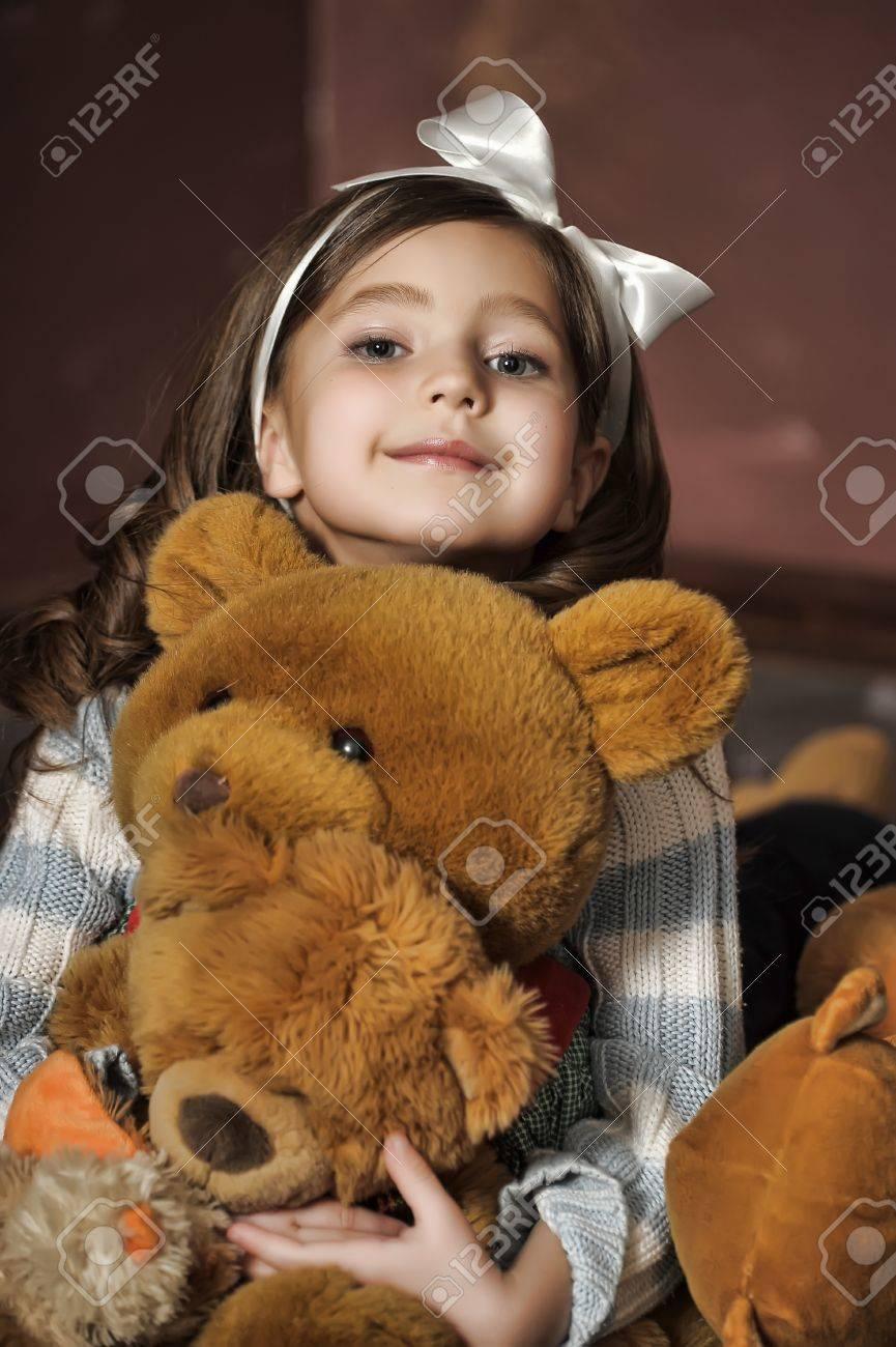 girl with a bear-cub Stock Photo - 13682111