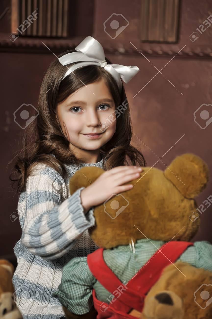 girl with a bear-cub Stock Photo - 13682109