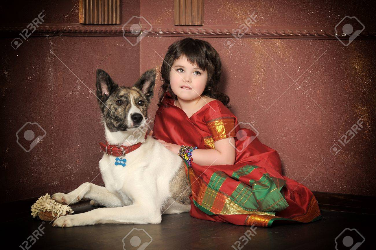 little girl in the national Indian suit with a dog Stock Photo - 13730918