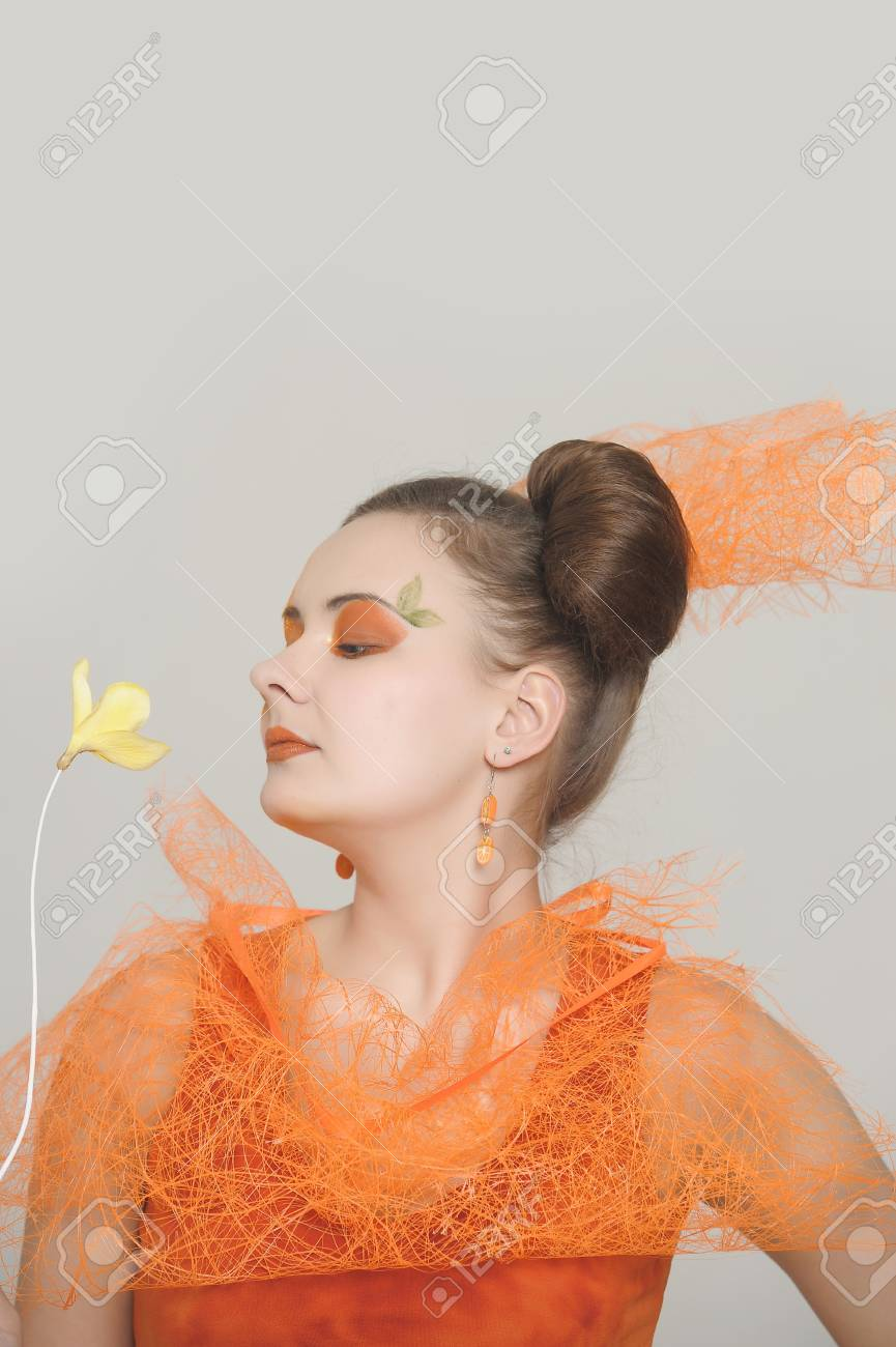 the orange girl with a yellow flower Stock Photo - 13682721