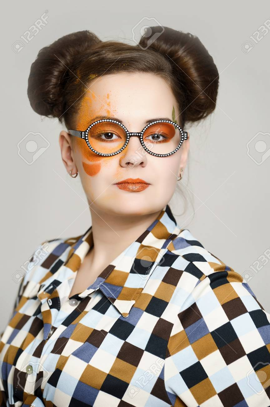the girl with a bright make-up wearing spectacles Stock Photo - 13682901