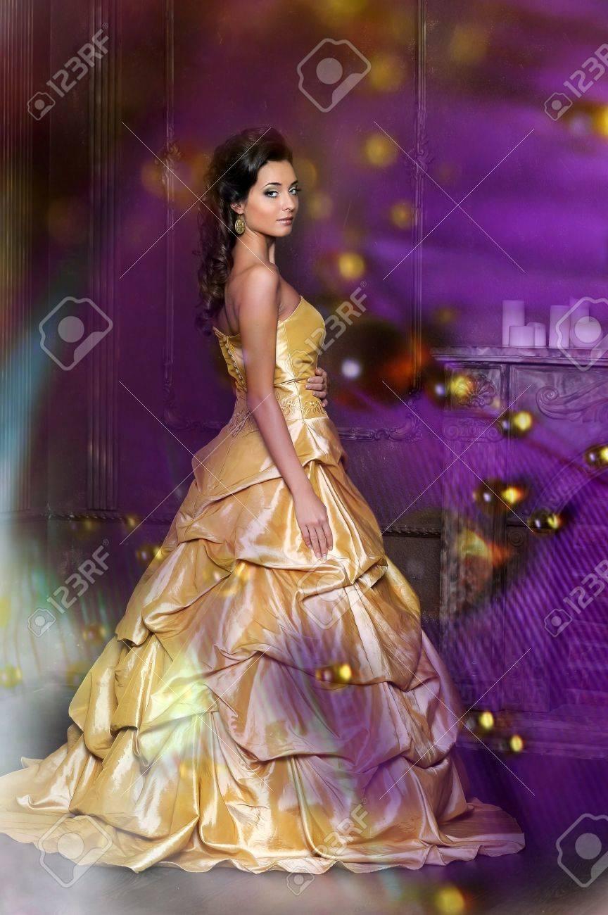 Beautiful girl in golden dress Stock Photo - 13837770