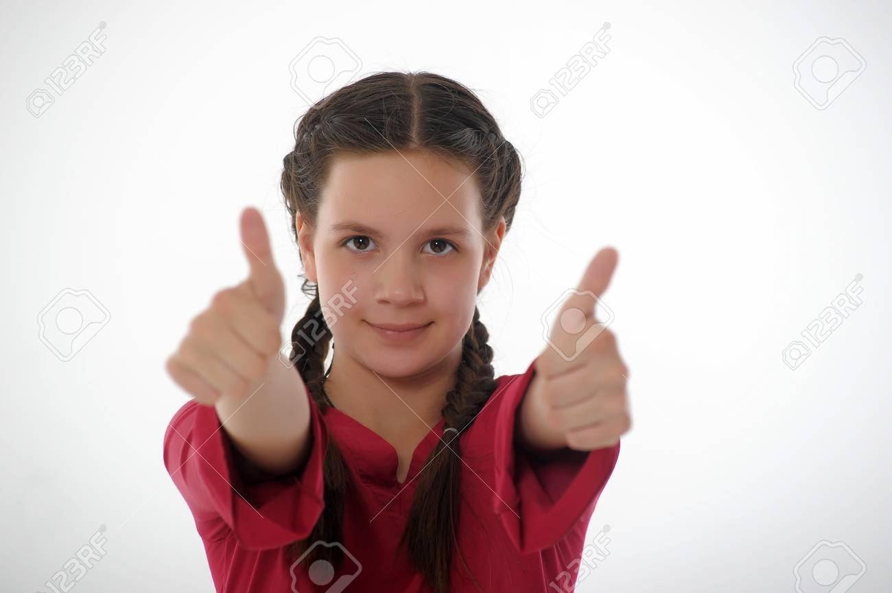 Closeup of girl showing thumbs up in both hands Stock Photo - 14329198