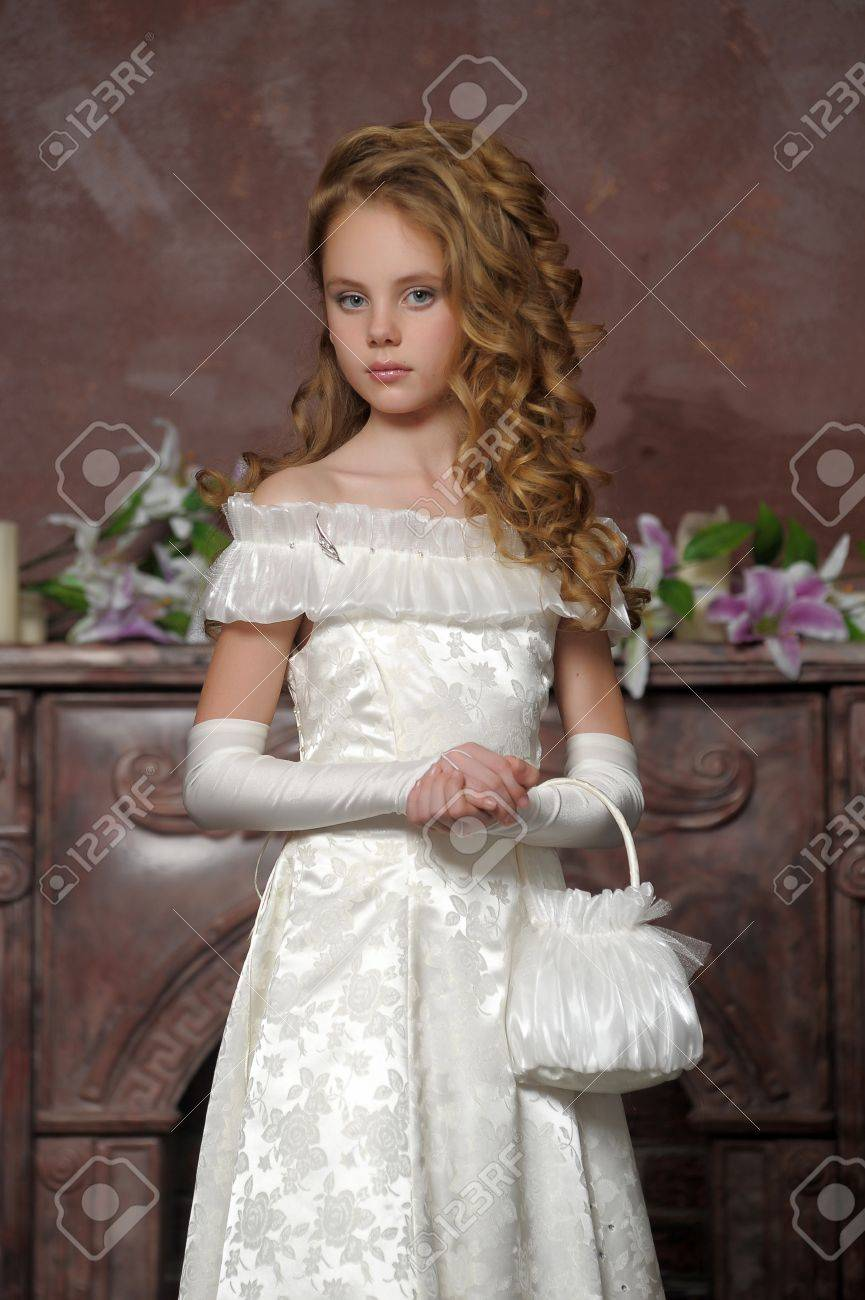 Girl in a smart white dress Stock Photo - 18273397