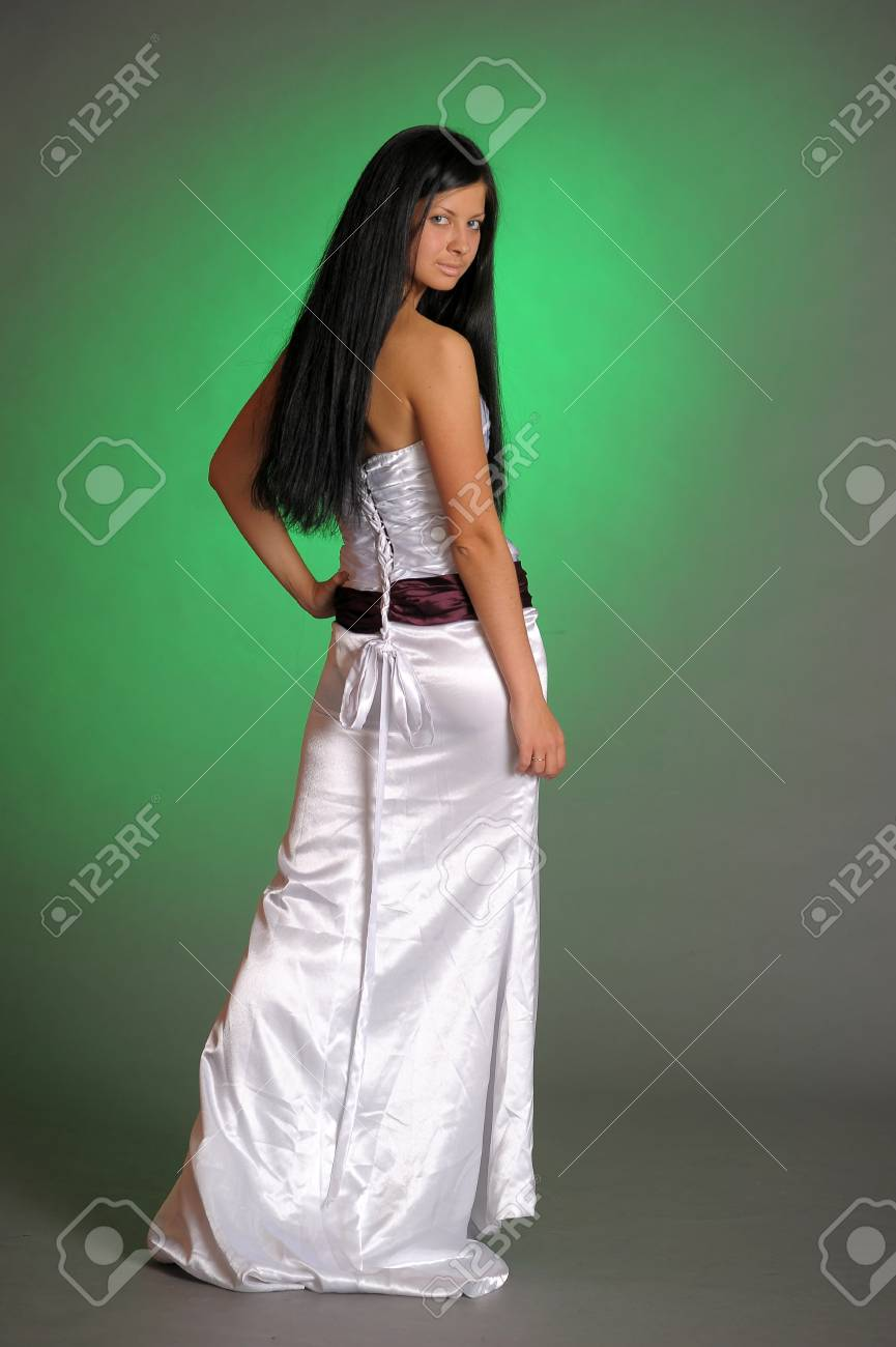 long-haired beautiful woman in a white dress Stock Photo - 14577979