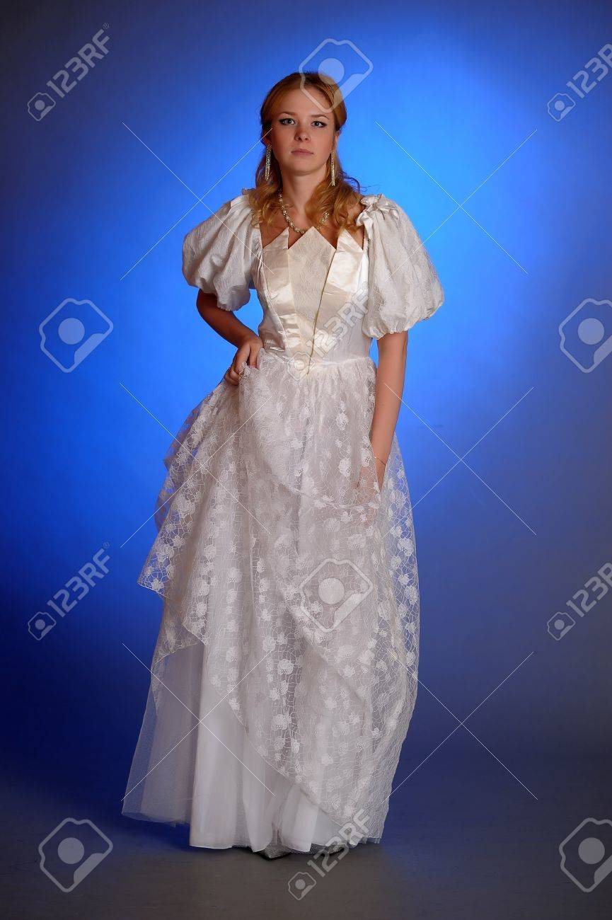 beautiful young woman in a wedding dress in the studio Stock Photo - 14293681