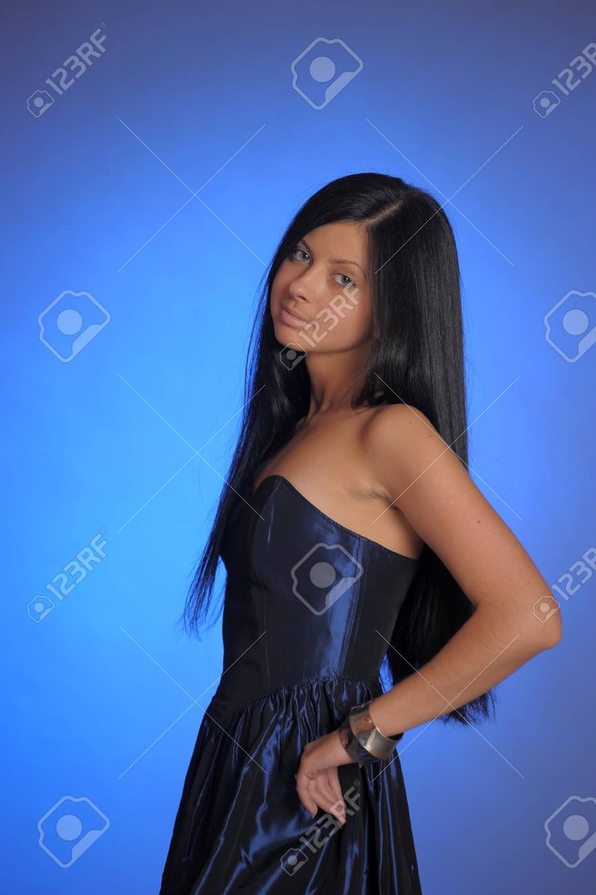 dark-haired girl in a blue dress Stock Photo - 18260955