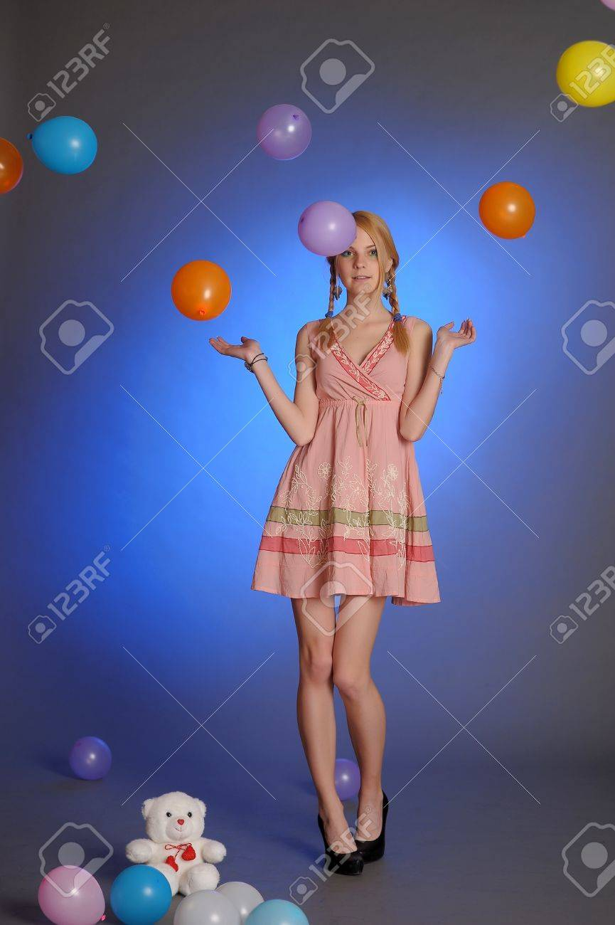 Girl With a studio with balloons Stock Photo - 14403190