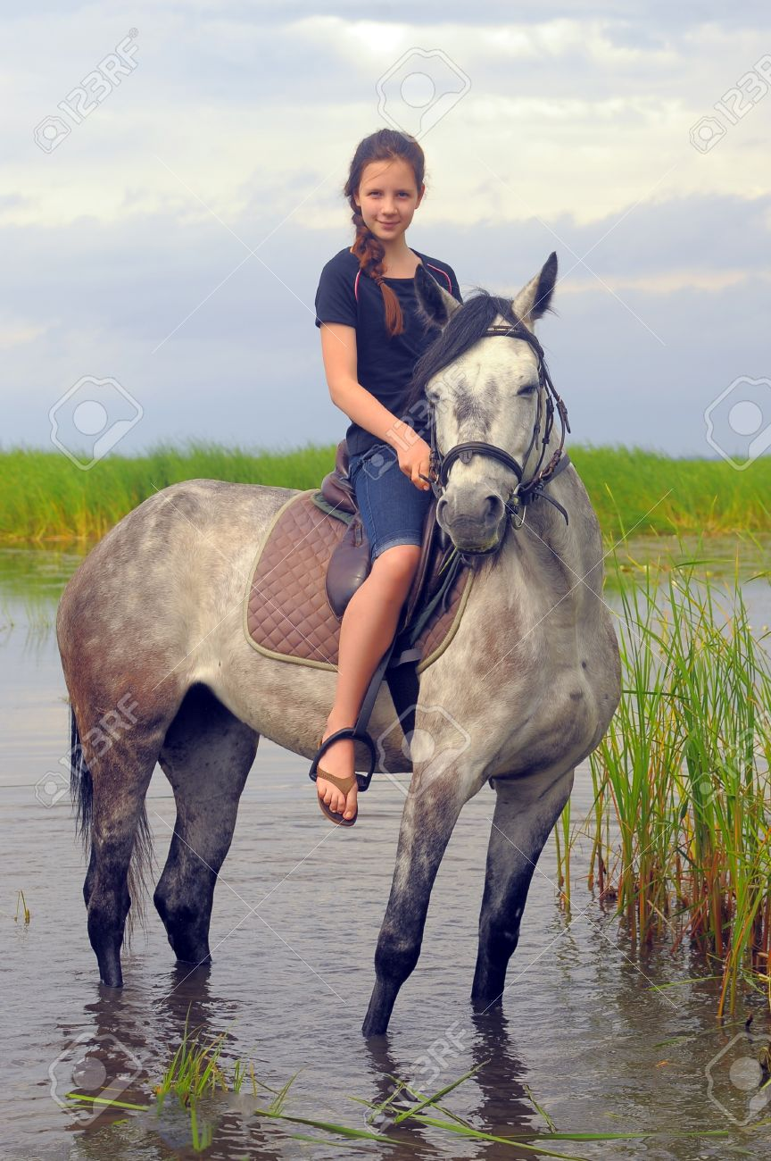 teen girl on a horse in the water Stock Photo - 14106127