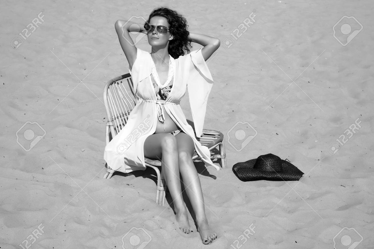 young woman sitting on the beach Stock Photo - 14202739