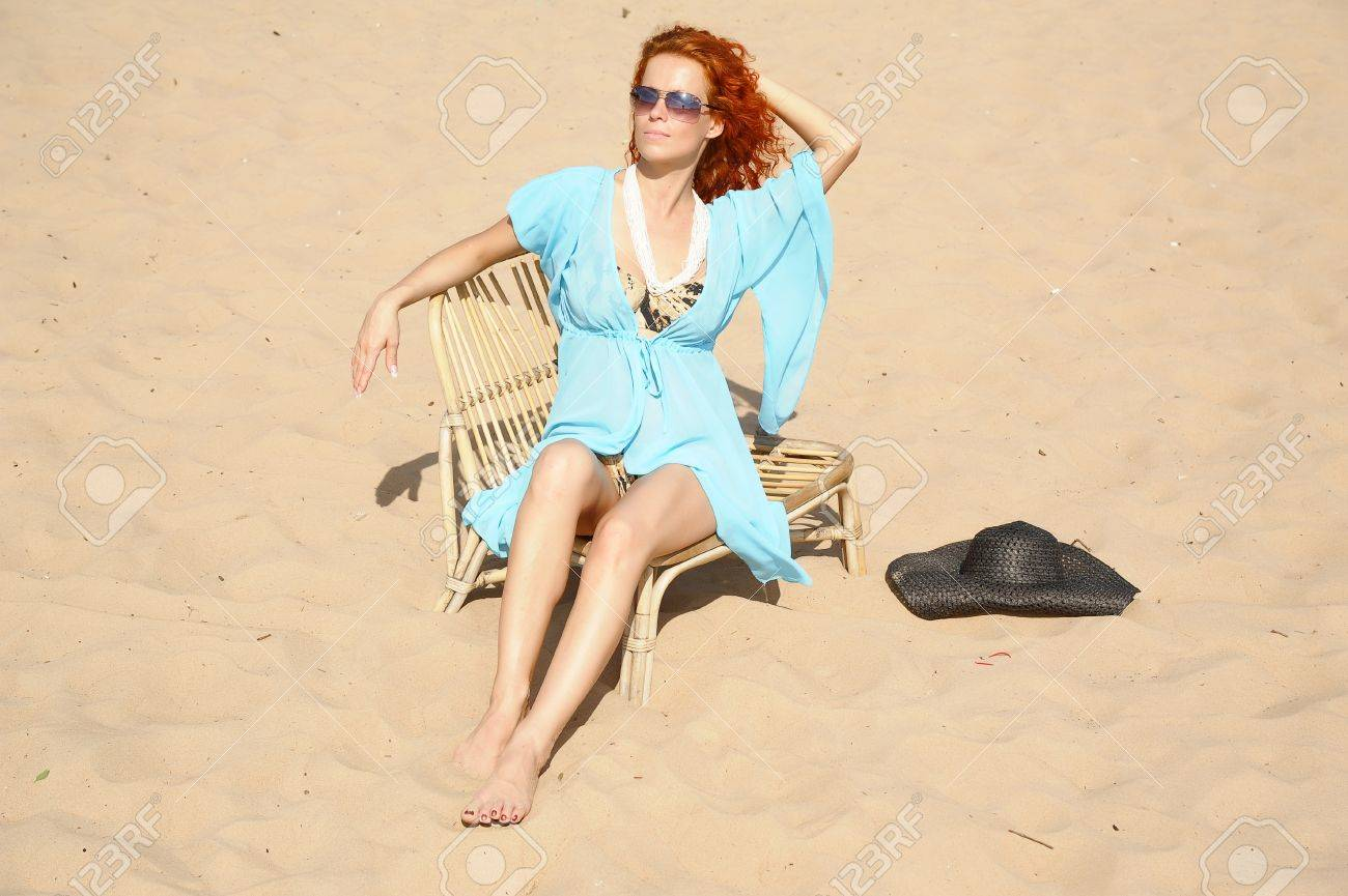 young woman sitting on the beach Stock Photo - 14202746