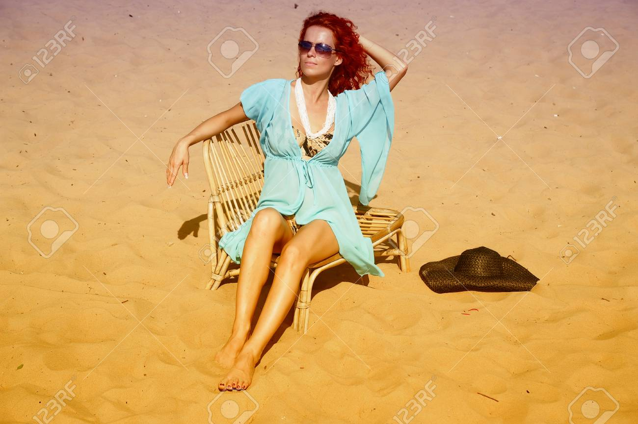 young woman sitting on the beach Stock Photo - 14202748