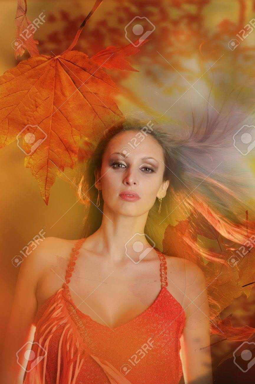 Autumn portrait of a beautiful young woman Stock Photo - 14231983