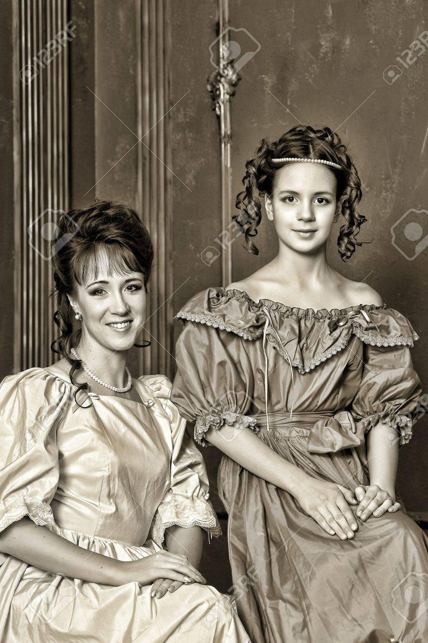Two ladies in medieval dresses, sepia photos Stock Photo - 14235671