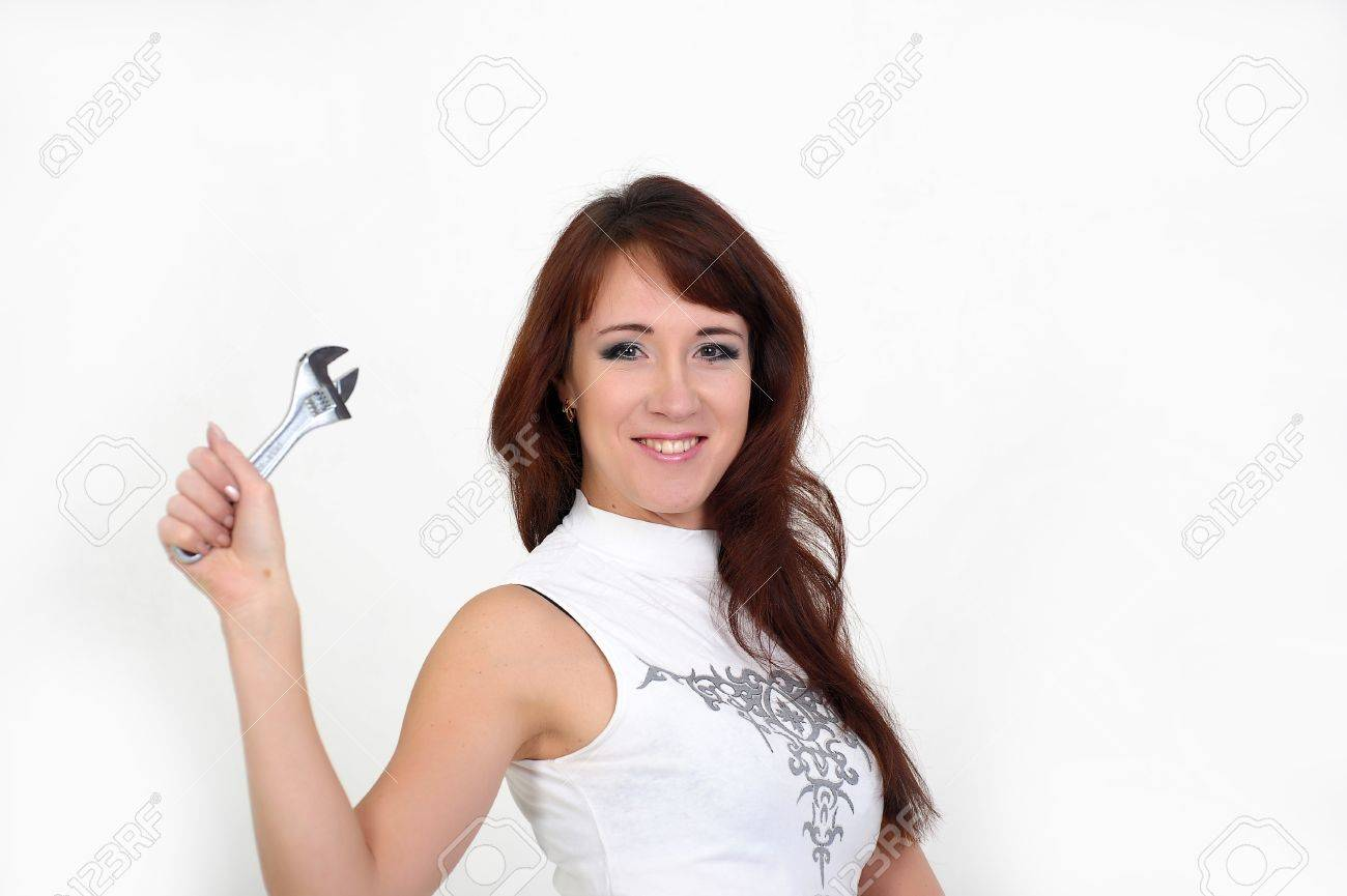 Beautiful young do-it-yourselfer holding a screw-wrench Stock Photo - 14229437