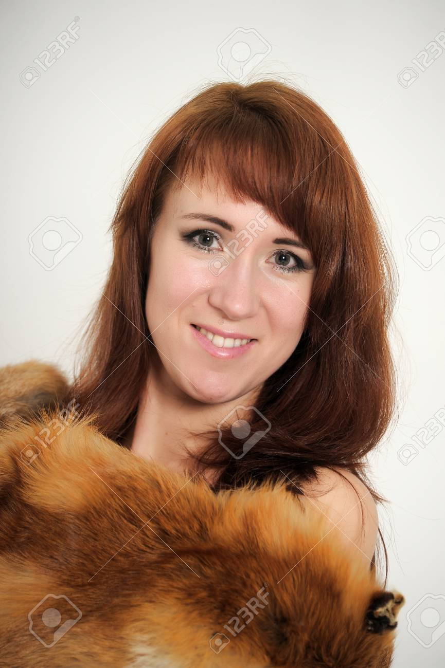 young woman with a fox fur on the shoulders Stock Photo - 14323354