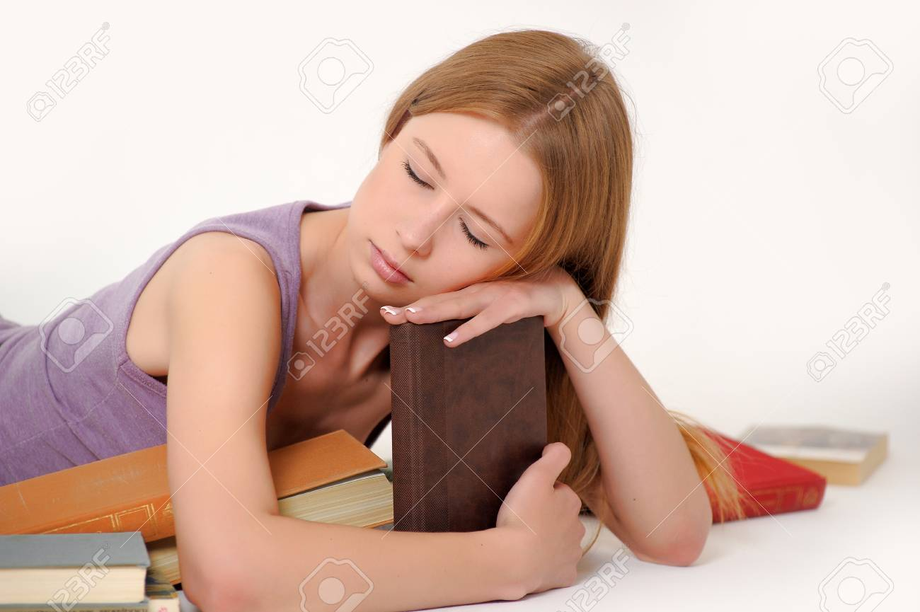Young student girl with book Stock Photo - 14321376