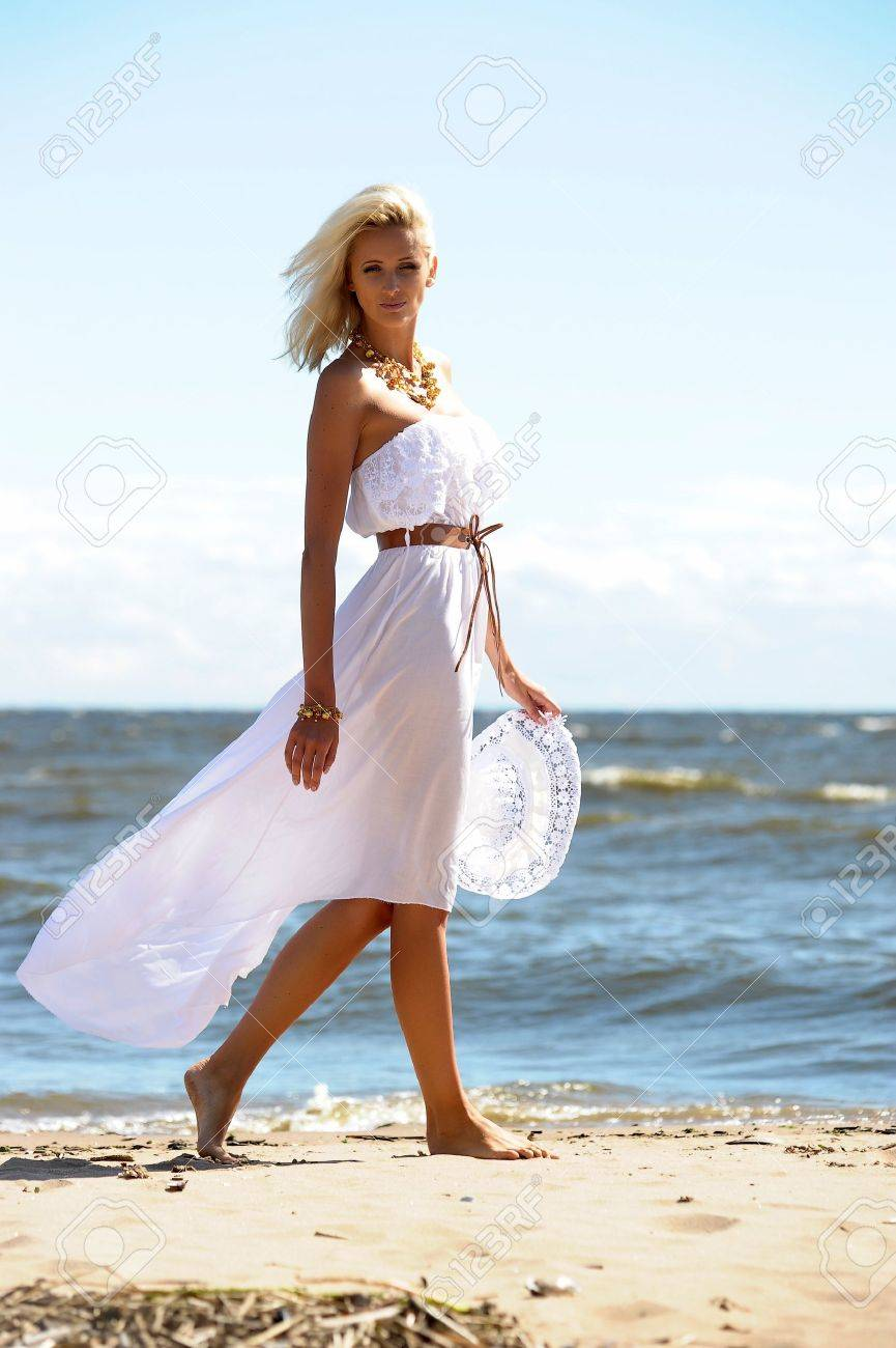 Girl in white dress on beach Stock Photo - 14552281