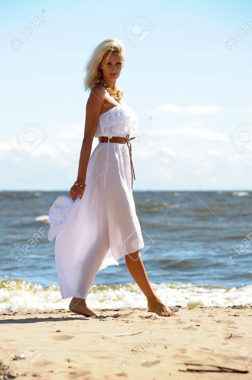 Girl in white dress on beach Stock Photo - 14552249