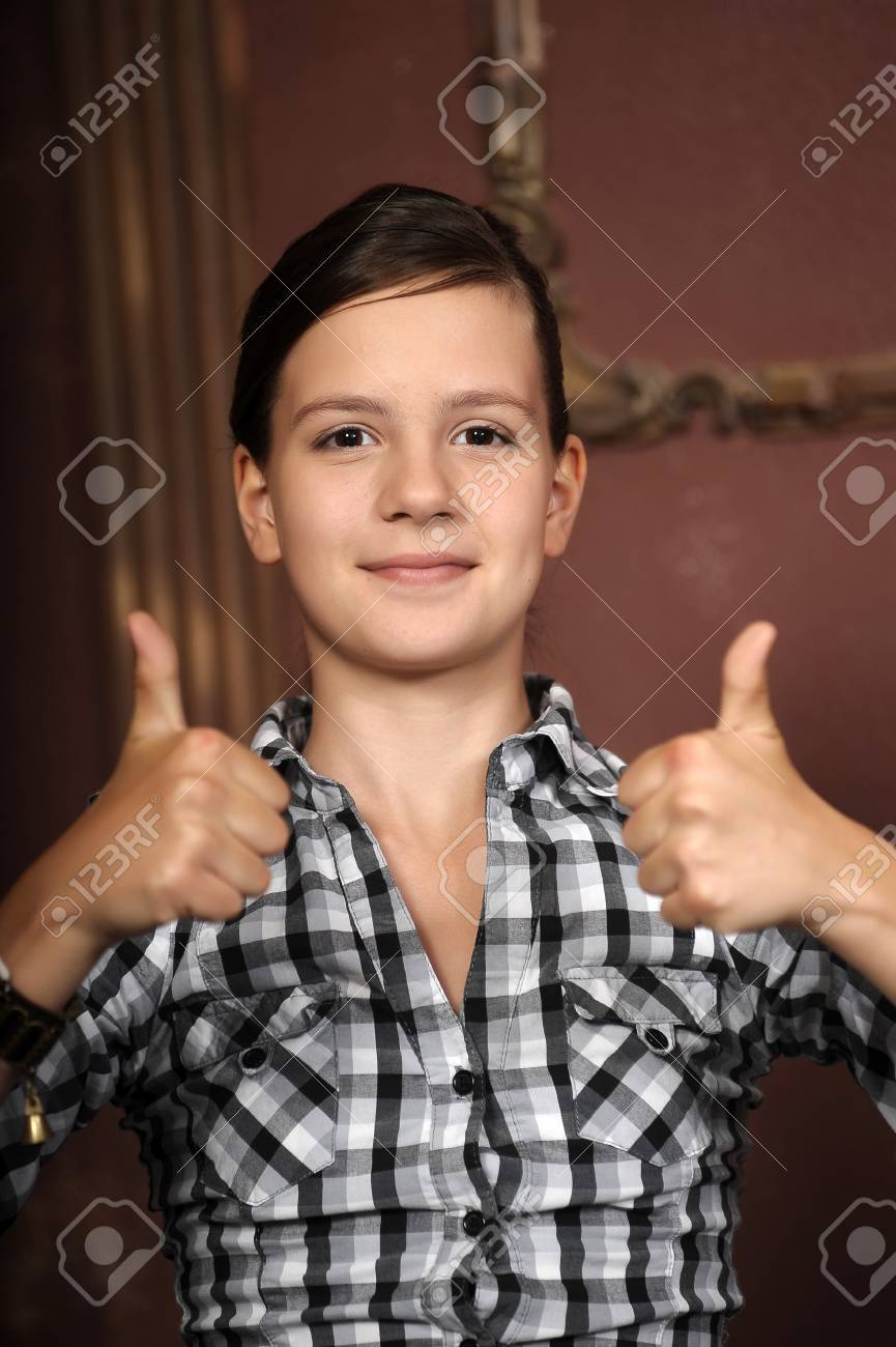 Teen beauty caucasian girl showing her thumbs up Stock Photo - 14979237
