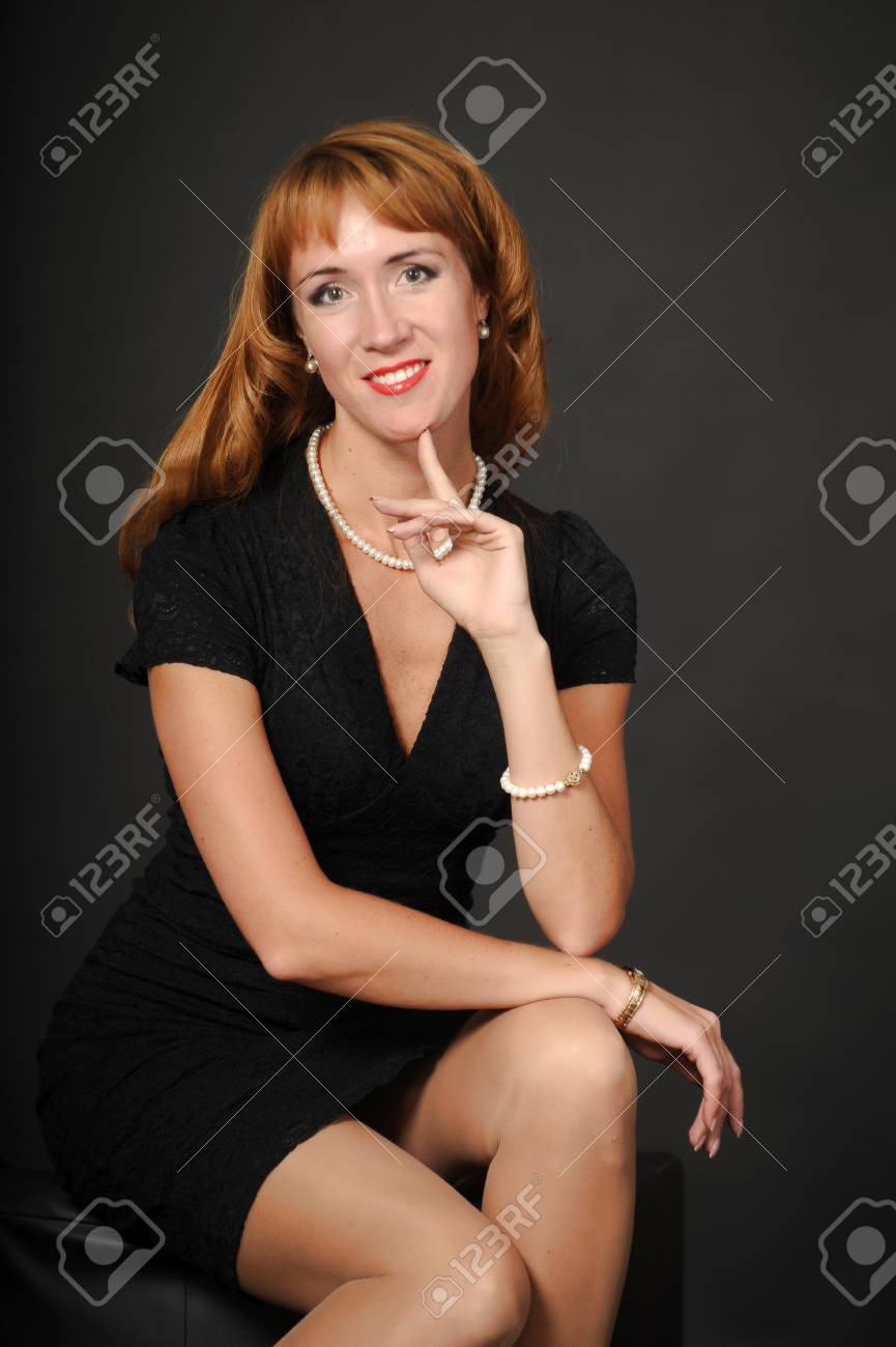 Portrait of red-haired girl in a black dress Stock Photo - 15036631