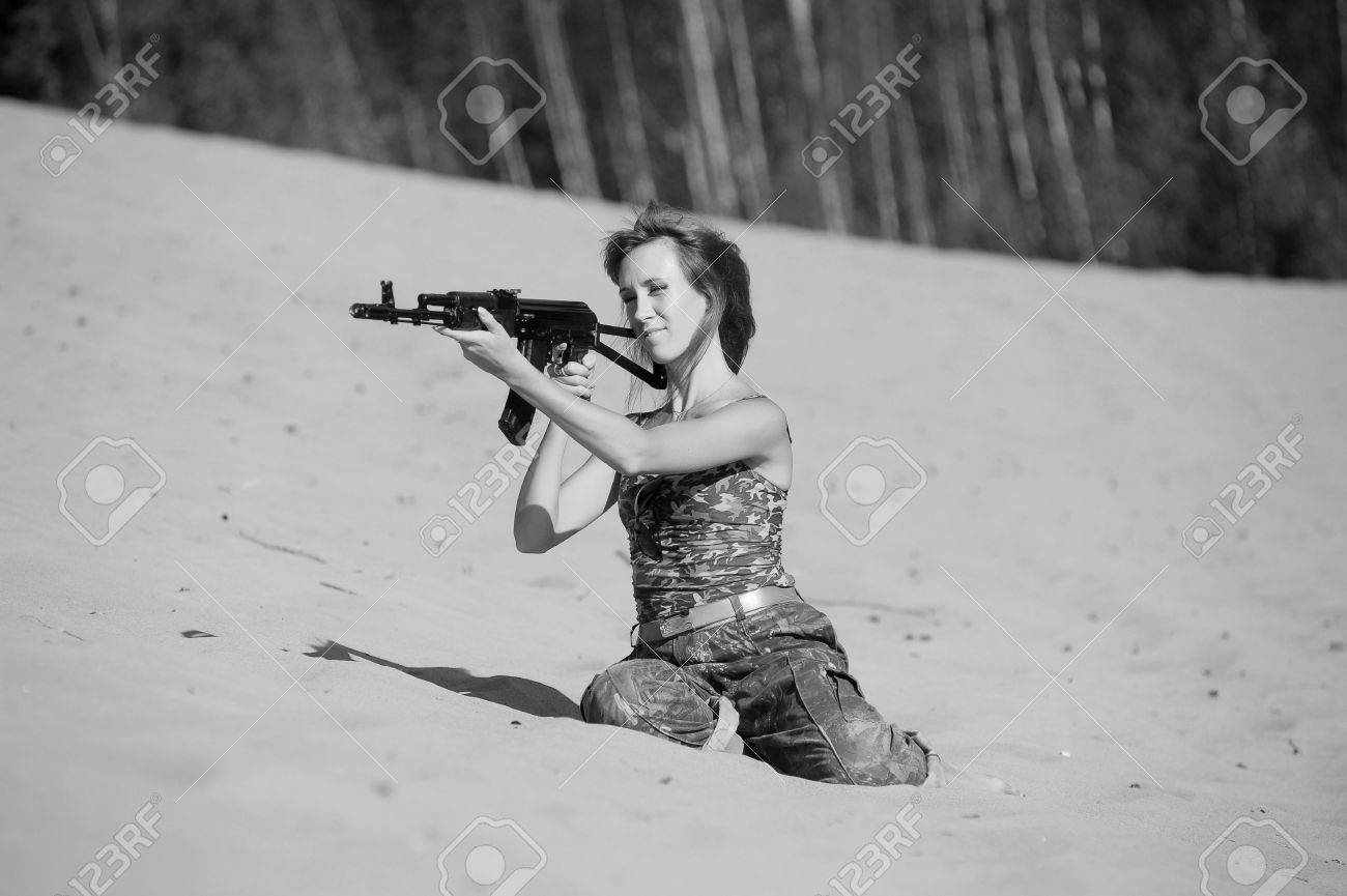Armed beautiful young woman Stock Photo - 15232903