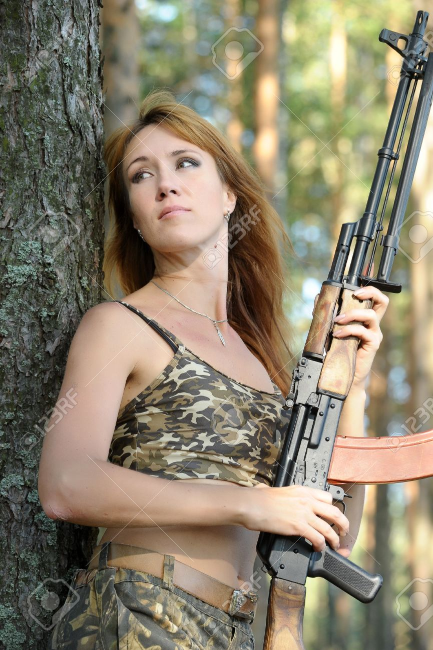 Armed beautiful young woman Stock Photo - 15232933