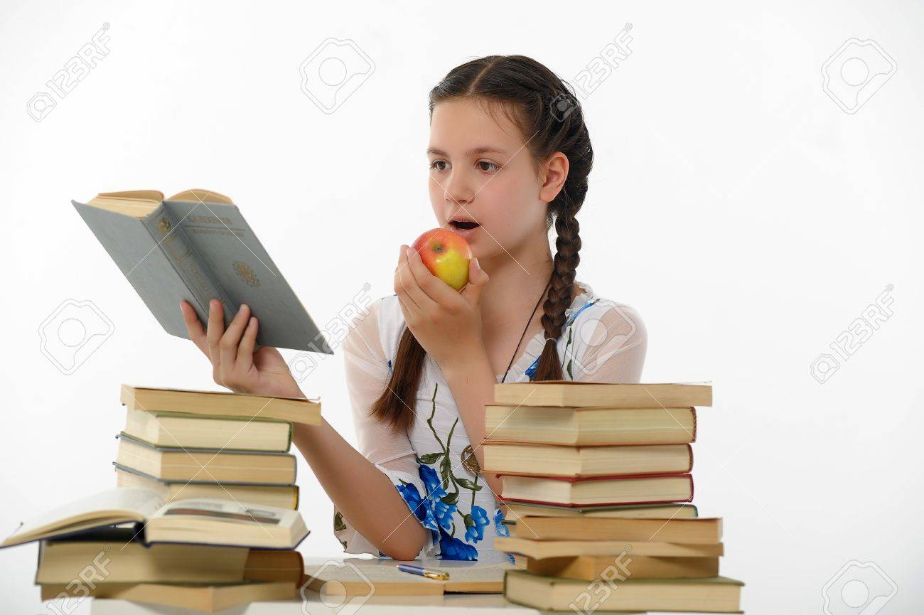 girl teenager and set of books Stock Photo - 15026625