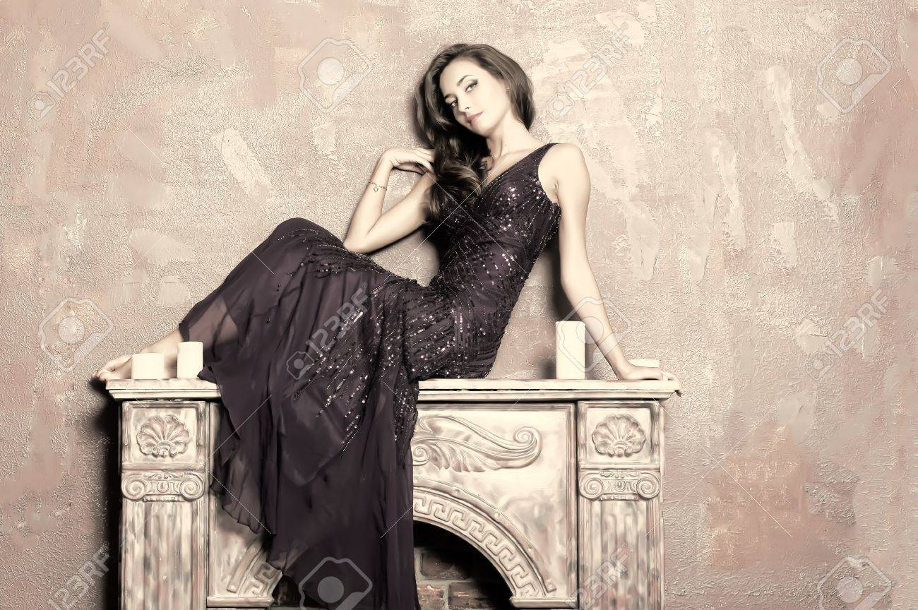 the girl sitting on a fireplace Stock Photo - 15169126
