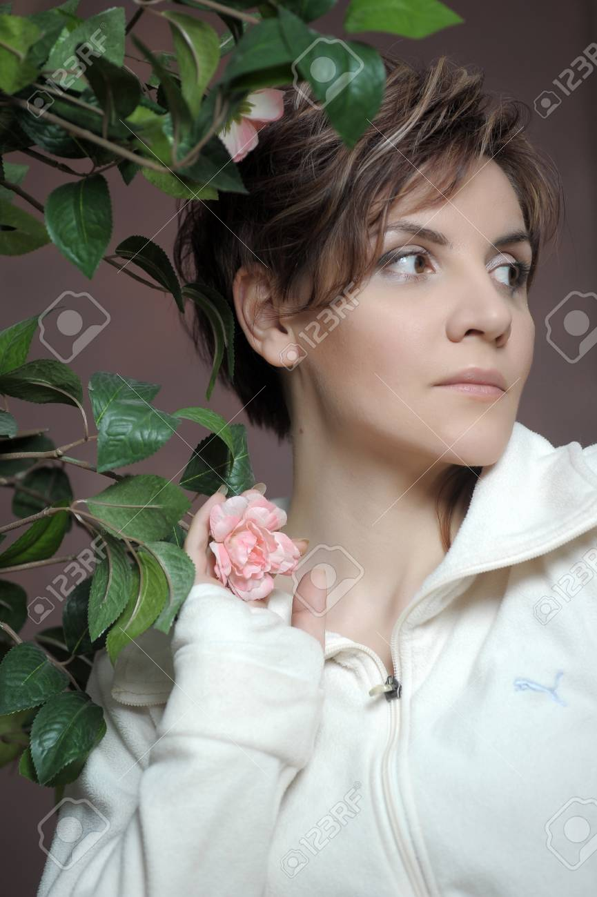 young elegant woman next to a bush of roses Stock Photo - 15482656