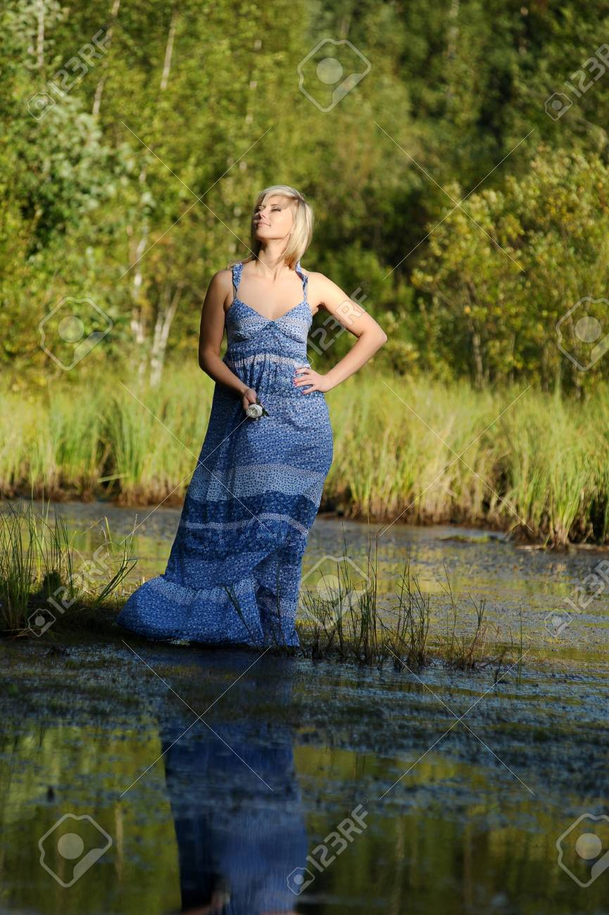 beautiful young woman in sundress near the lake Stock Photo - 15234104