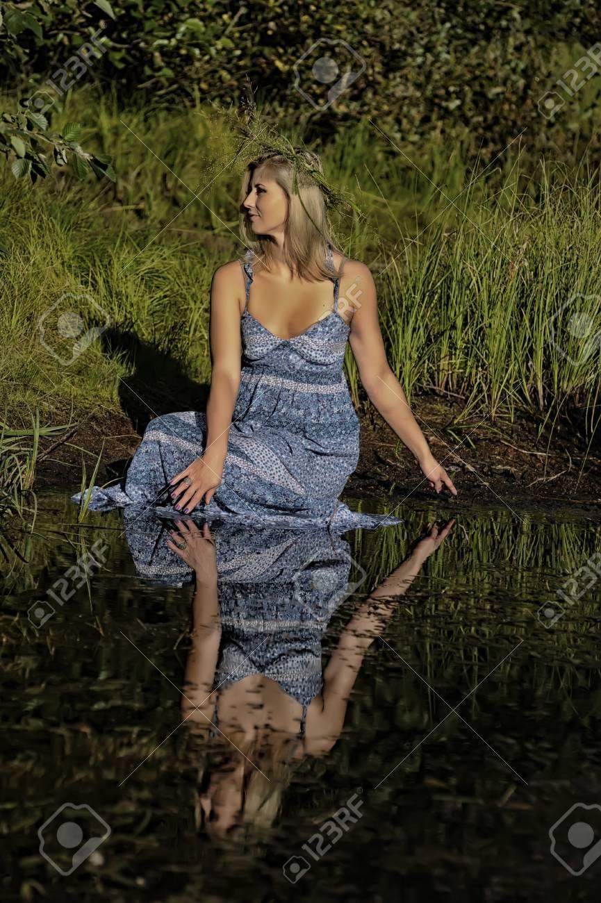beautiful young woman in sundress near the lake Stock Photo - 15337857