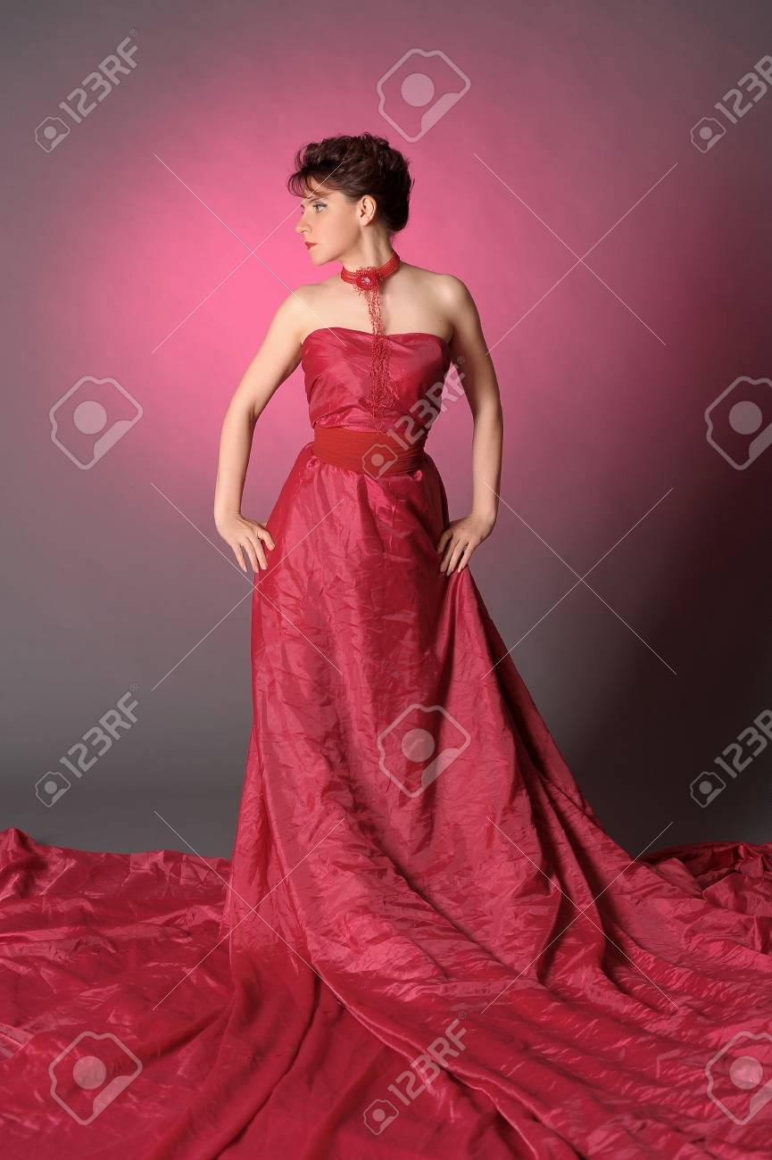 The beautiful girl in a long red dress Stock Photo - 15358161