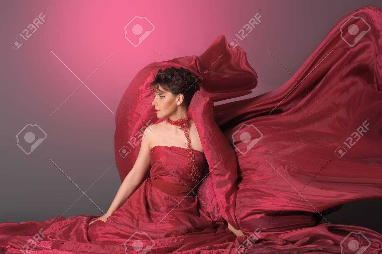 The beautiful girl in a long red dress Stock Photo - 15358143