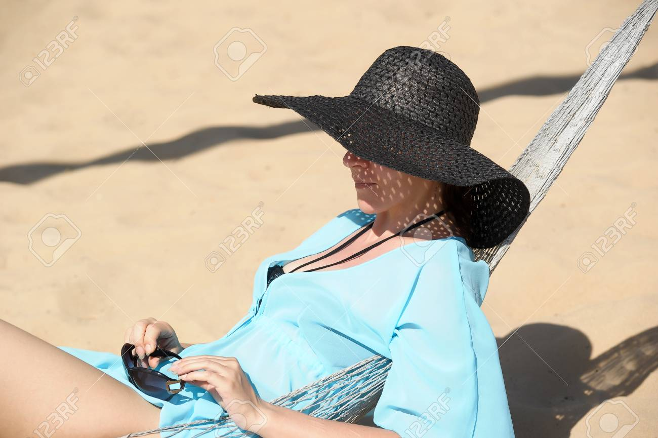 young woman in a hammock Stock Photo - 19029947