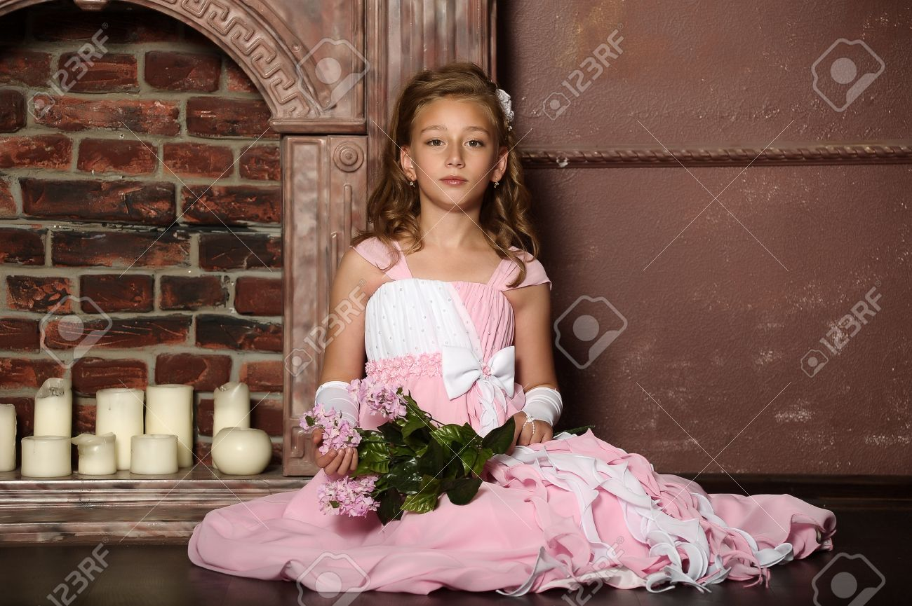 nude little princess small child nude: little princess in a pink dress Stock Photo