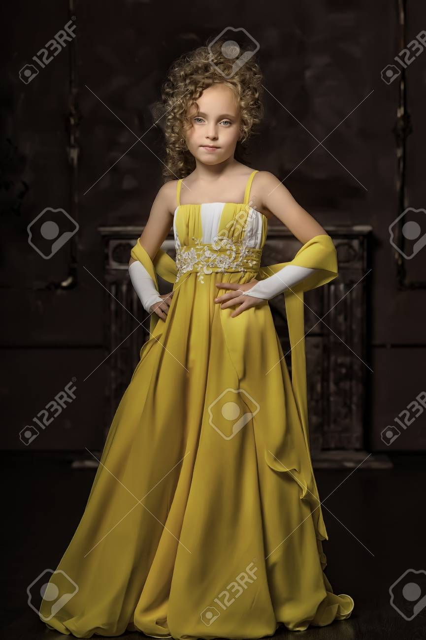 Girl in a yellow dress Stock Photo - 17935306