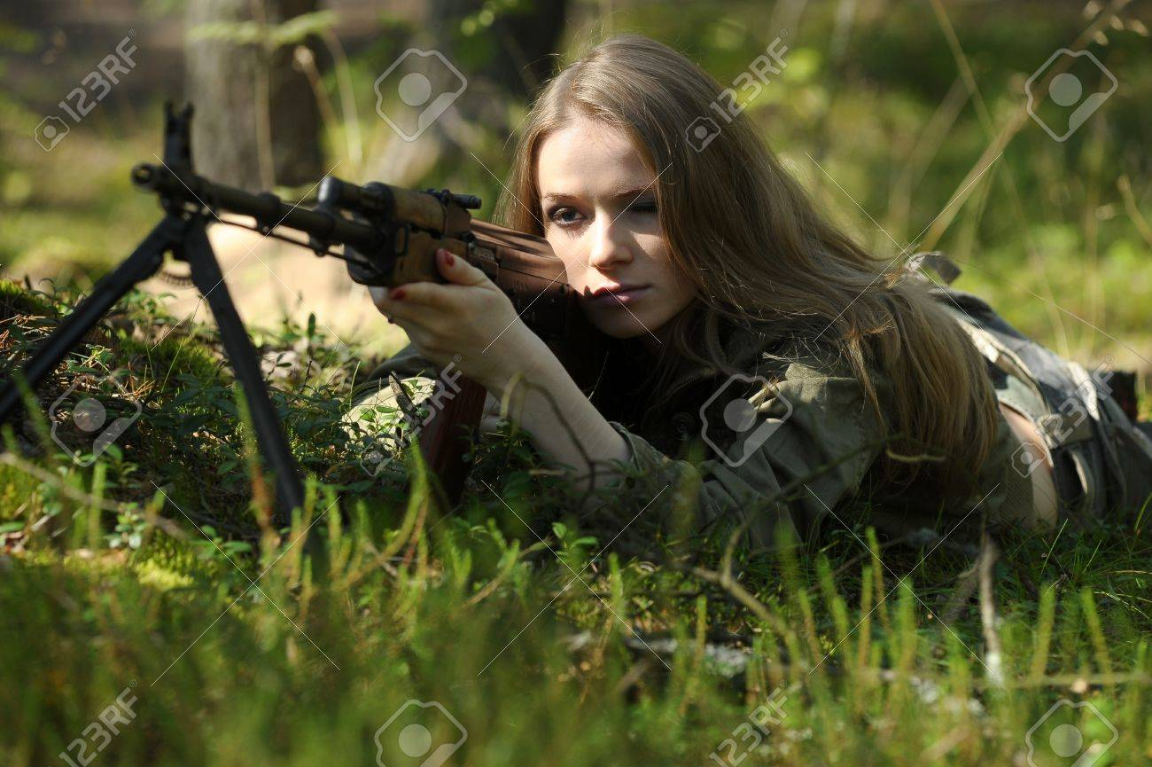 young blonde with a rifle in his hands Stock Photo - 15424962