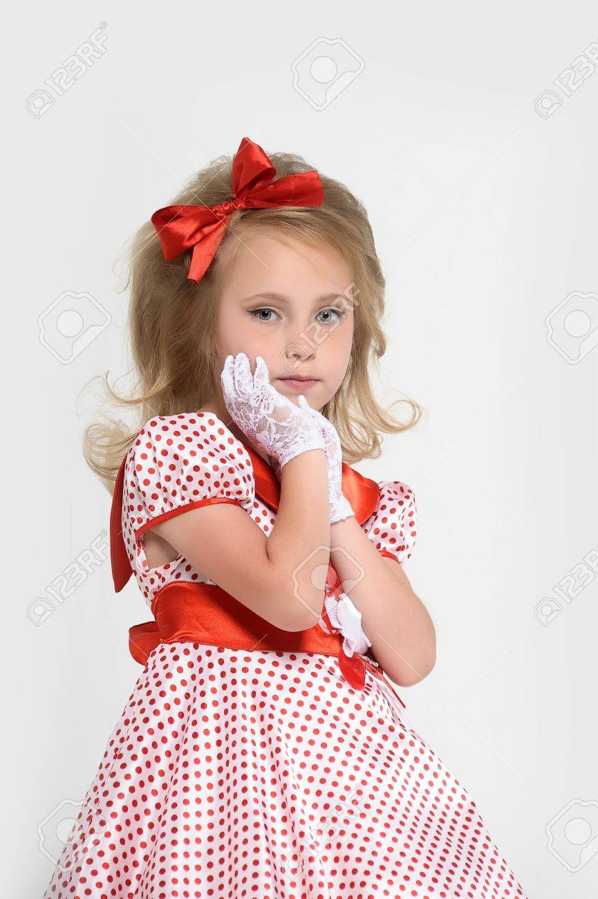 a little girl dressed in the style of the 60s Stock Photo - 15429022