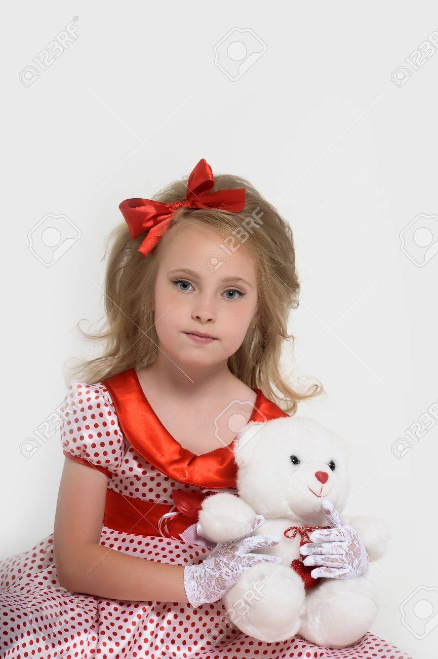a little girl dressed in the style of the 60s Stock Photo - 15429018