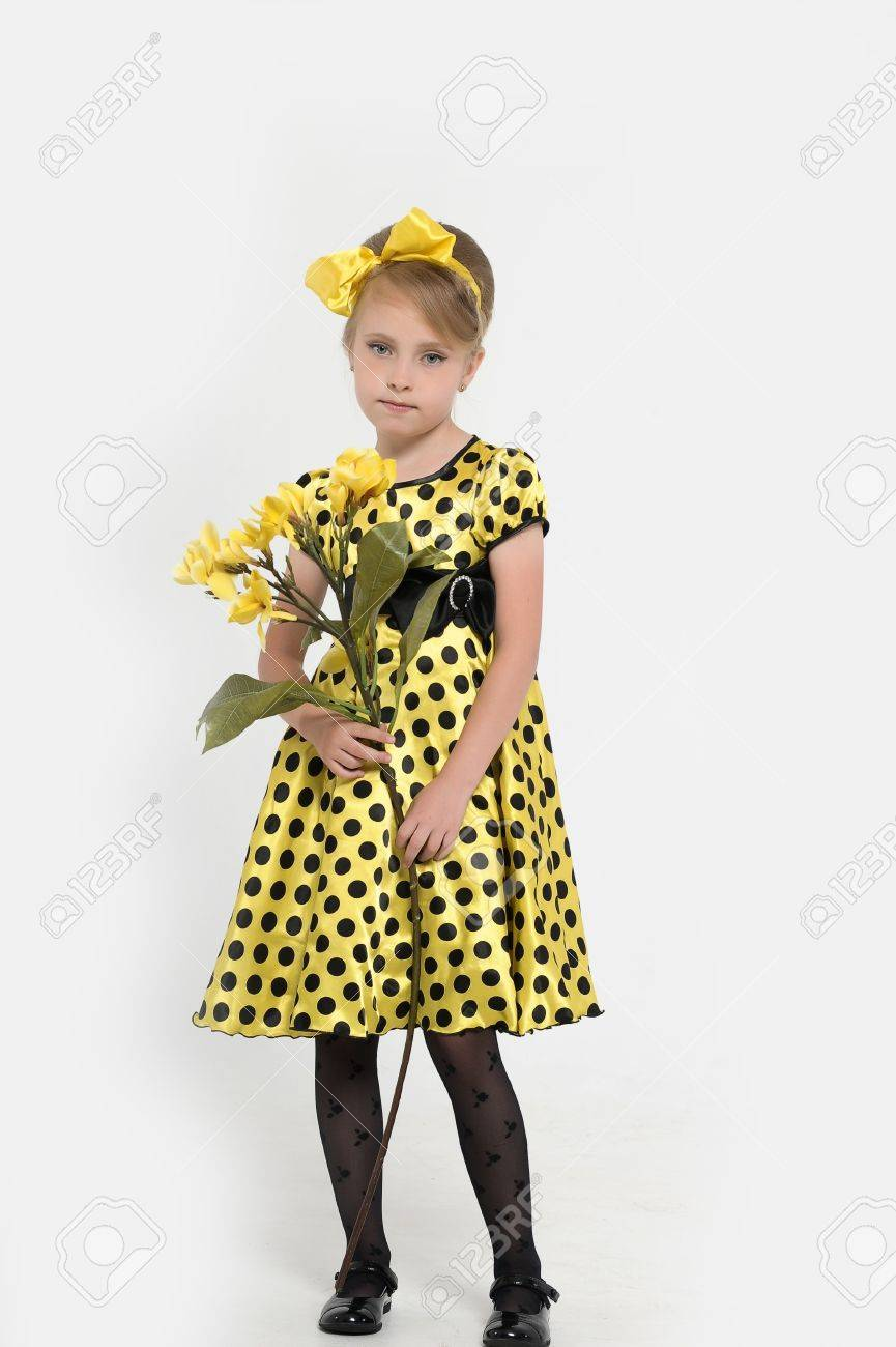 A little girl dressed in the style of the 60s Stock Photo - 15479599