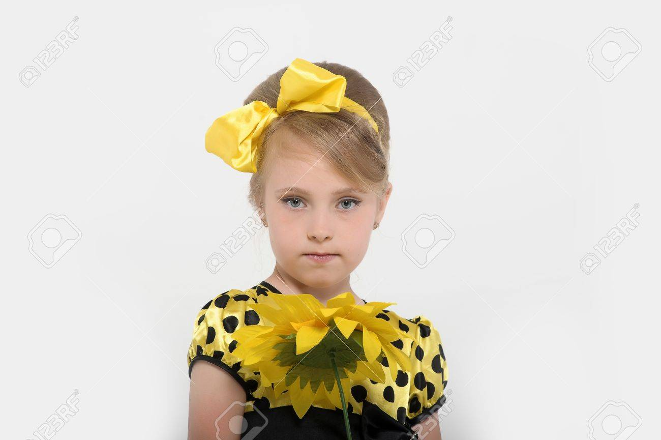 A little girl dressed in the style of the 60s Stock Photo - 15479597