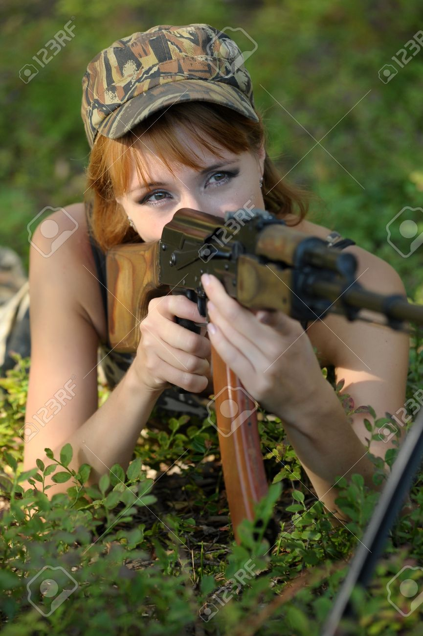 Armed beautiful young woman Stock Photo - 15353271