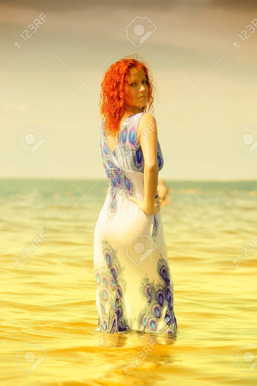 young woman in a dress in the water Stock Photo - 15412348