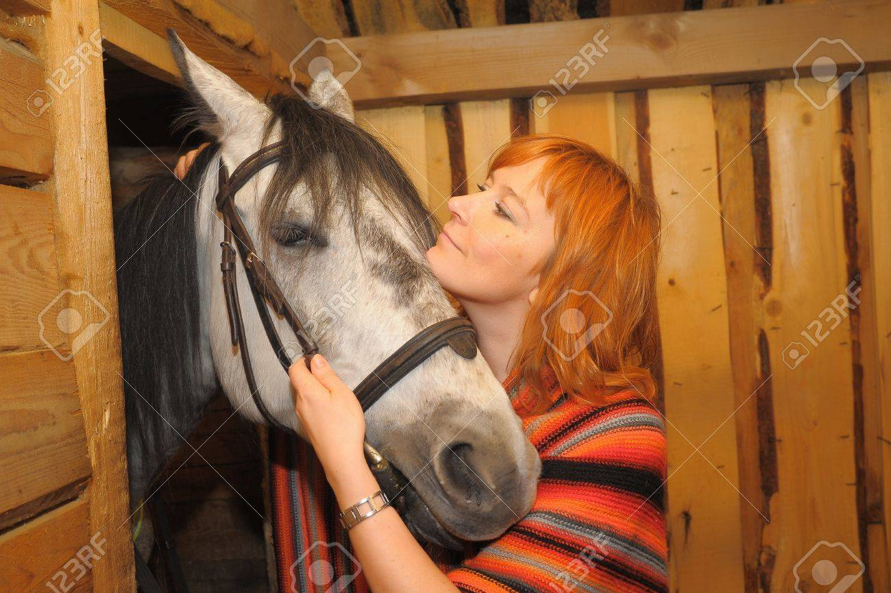 a woman with a horse Stock Photo - 15803260