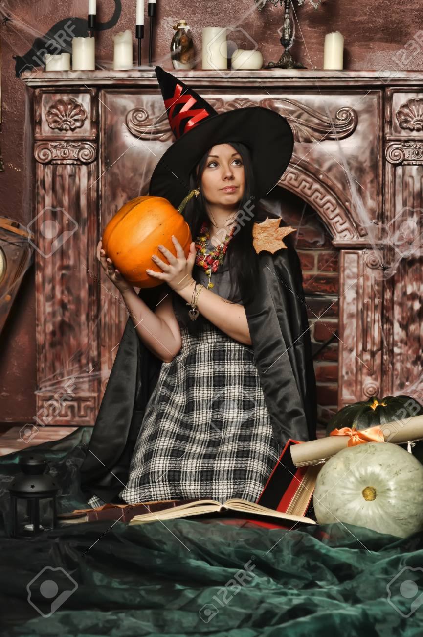 Witch with pumpkin Stock Photo - 19000506