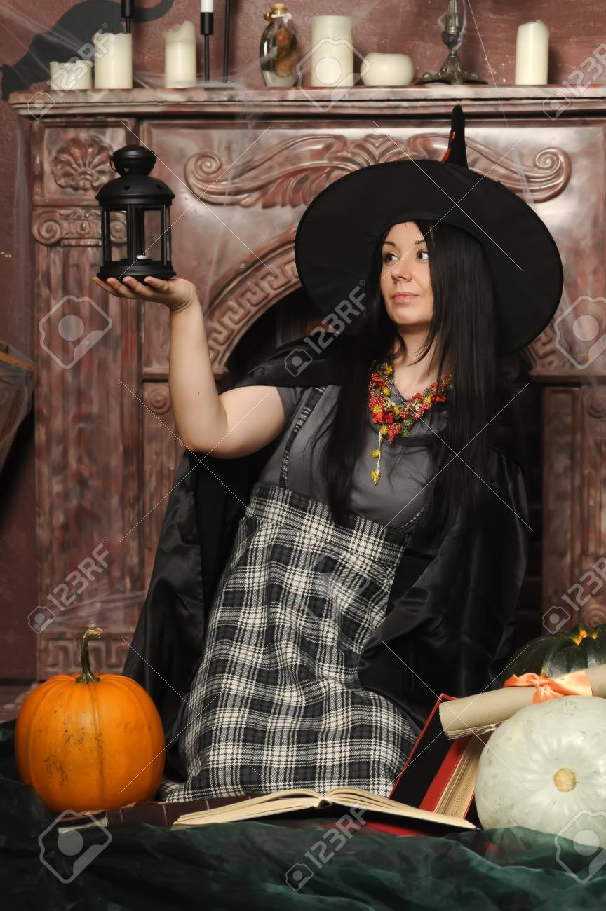 Witch with pumpkin Stock Photo - 19000503